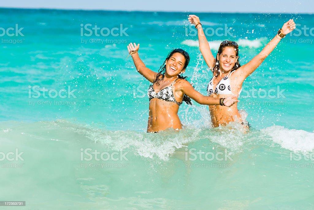 Young girls splashing and having fun royalty-free stock photo