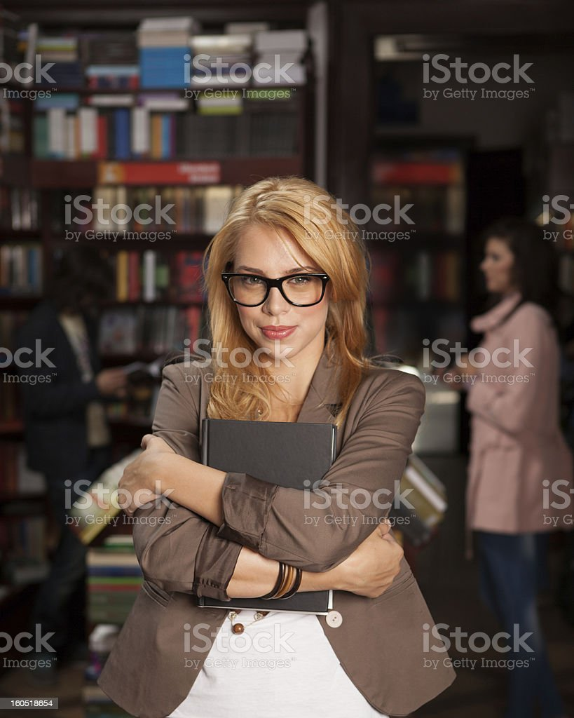 young girls with book in her arms royalty-free stock photo