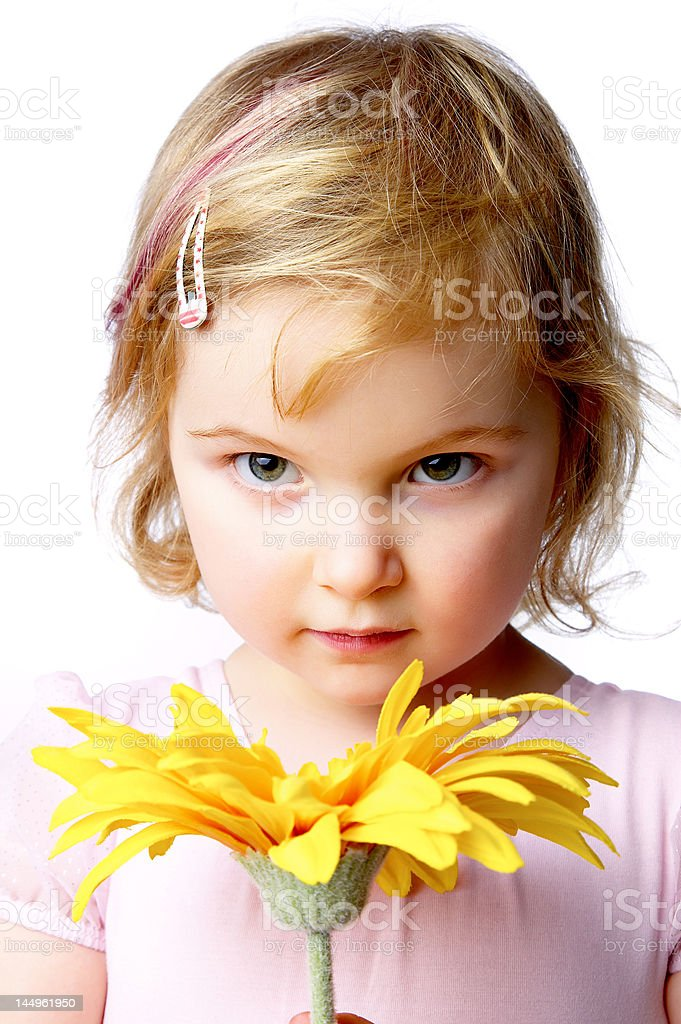 Young girls with flowers stock photo