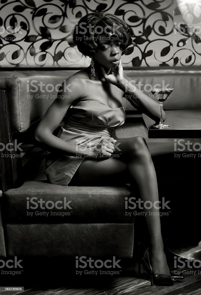 Young glamourous fashion model having a cocktail stock photo