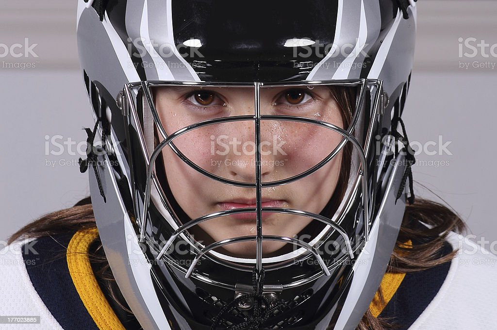Young goaltender with facemask royalty-free stock photo