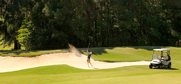 Young Golfer in Sand Bunker