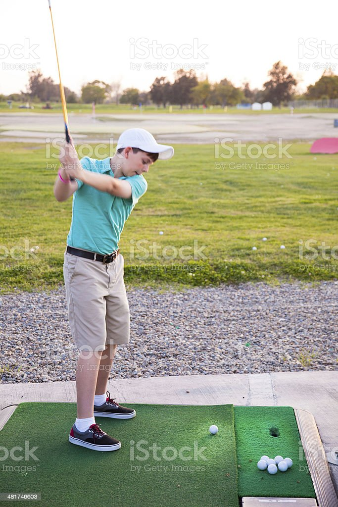 Young Golfer on Driving Range stock photo