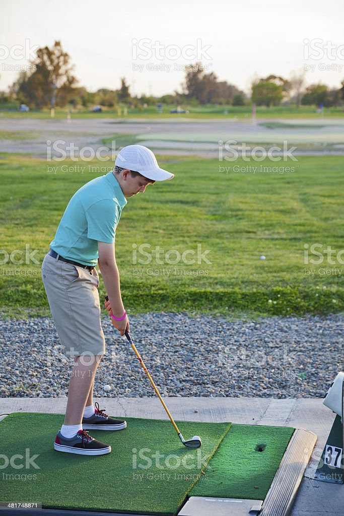 Young Golfer Practice stock photo
