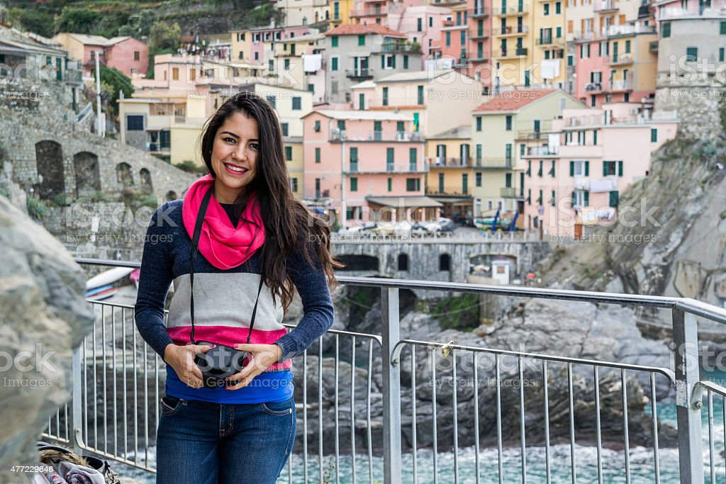 Young good looking taking photos at Manarola stock photo