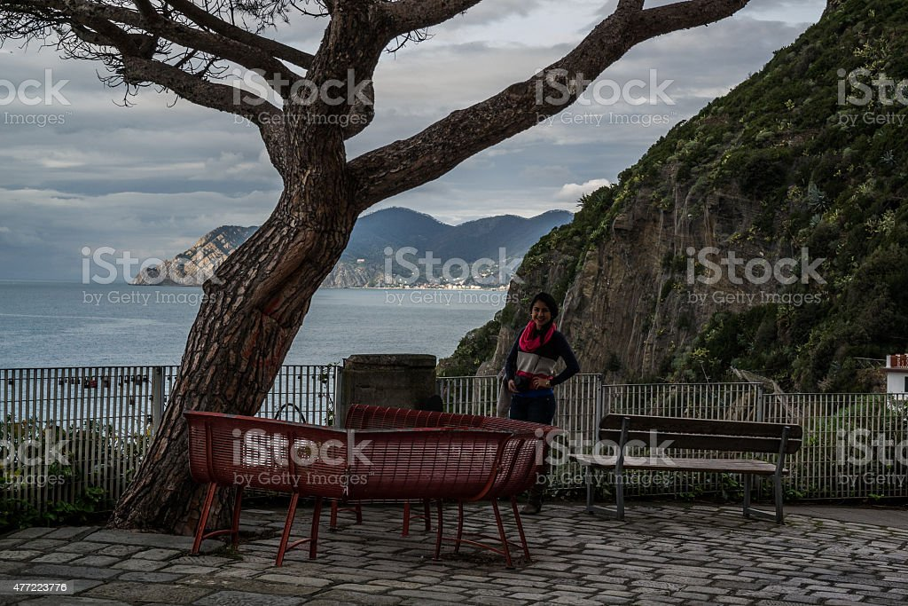 Young good looking woman visiting Riomaggiore stock photo