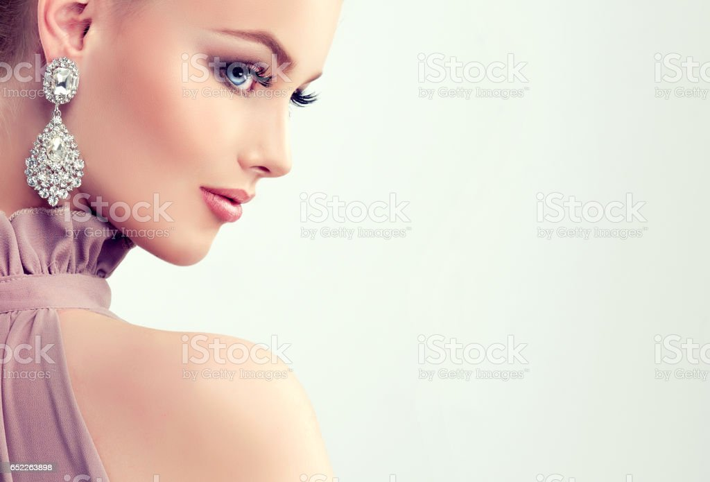 Young gorgeous girl dressed in evening gown and delicate makeup on. - foto de stock