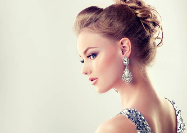 Young gorgeous girl dressed in evening gown and delicate makeup on. stock photo