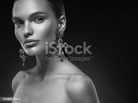 Young gorgeous girl in evening gown and delicate make-up