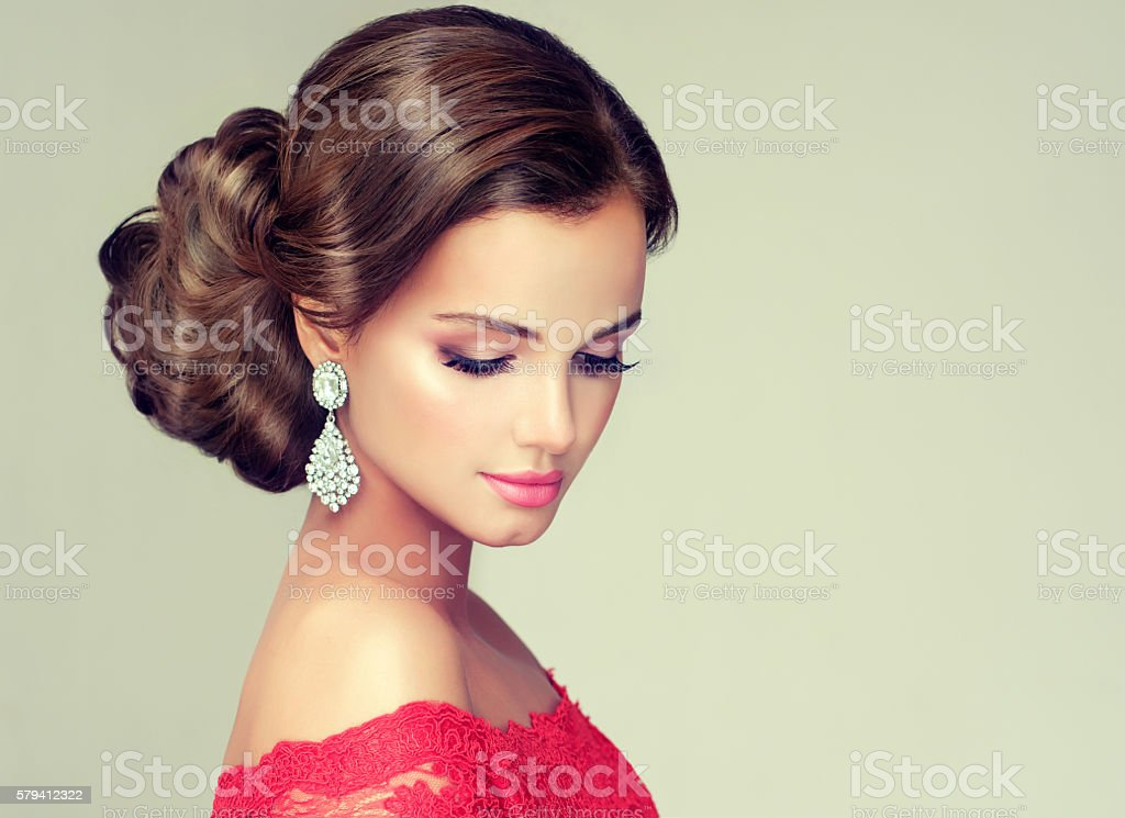 Young, gorgeous model dressed in a wedding and evening style. stock photo