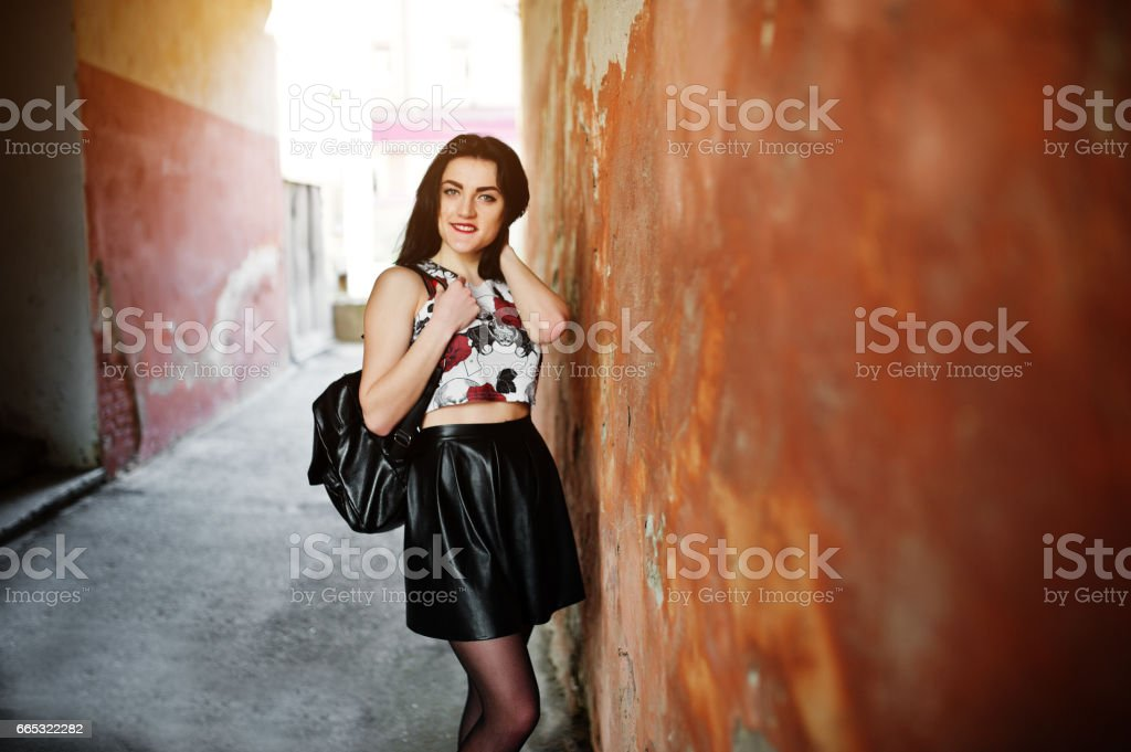 Young goth girl on black leather skirt stock photo