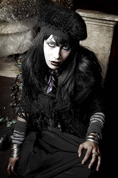 young gothic dressed woman posing - gothic fashion stock photos and pictures