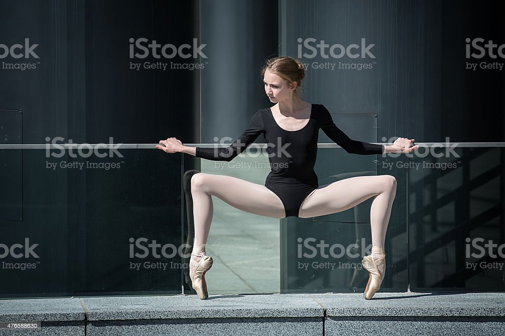 Young graceful ballerina in black bathing suit on a background stock photo