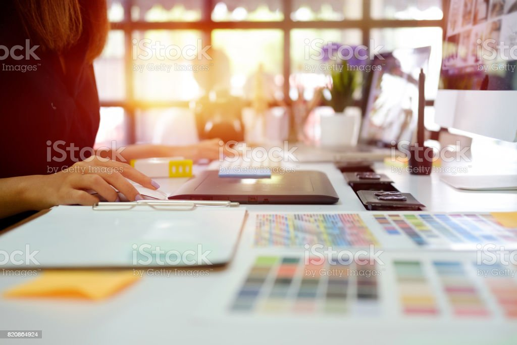 Young graphic designer at work in office. stock photo