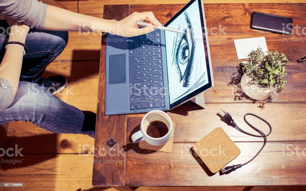 Young graphic designer drawing on graphics tablet stock photo