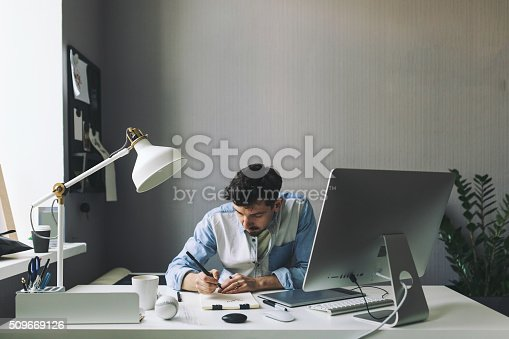 istock Young graphic designer working in office 509669126