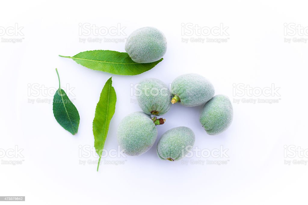 Young Green Almonds on White Background stock photo