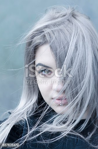istock Young grey haired girl portrait in the wind 637625470
