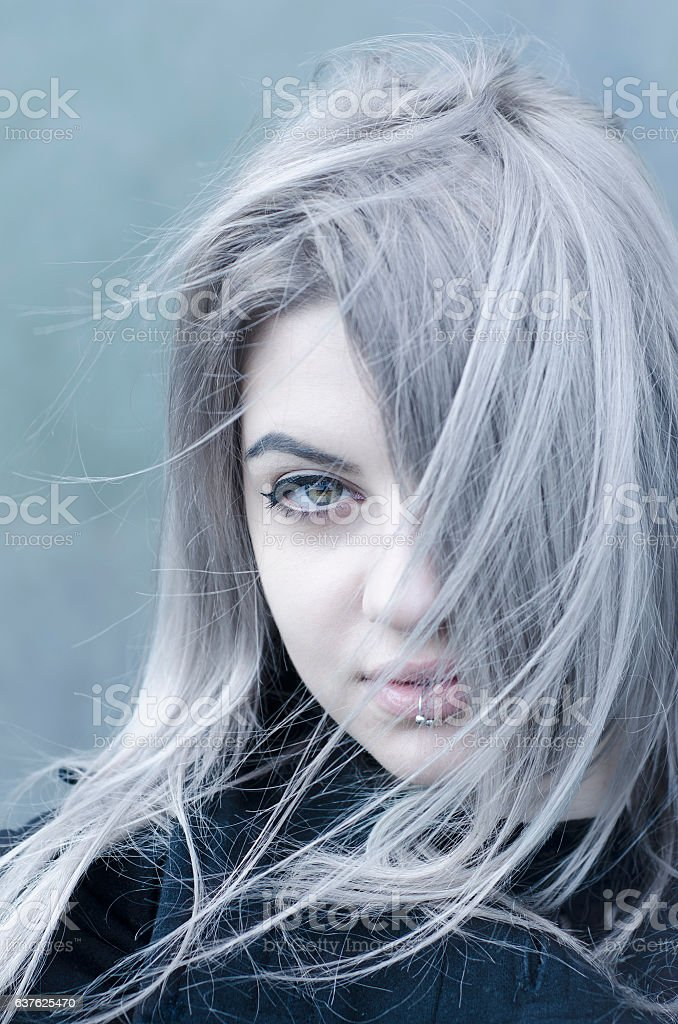 Young grey haired girl portrait in the wind stock photo
