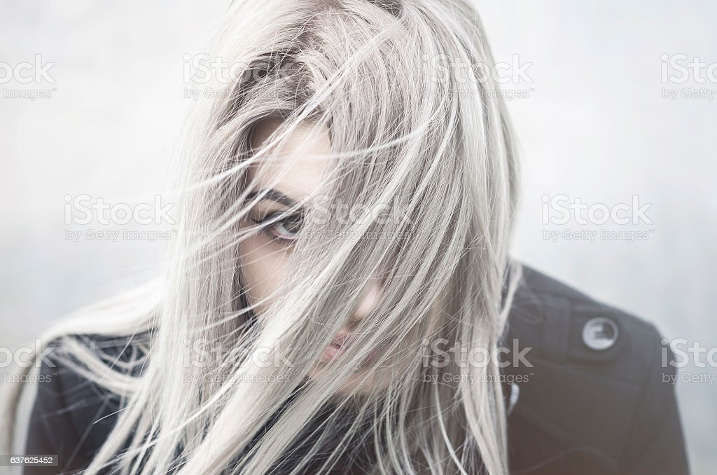 Young grey haired girl portrait with covered face photo libre de droits