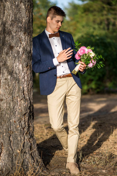 Young groom in the park stock photo