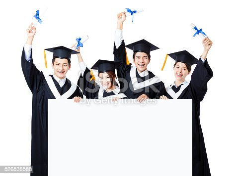 528291188 istock photo young Group of graduate students presenting empty banner 526538588