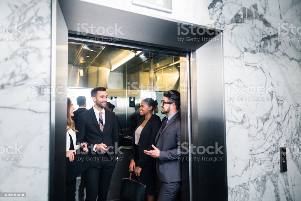 Young group of latin millennial executives in elevator stock photo