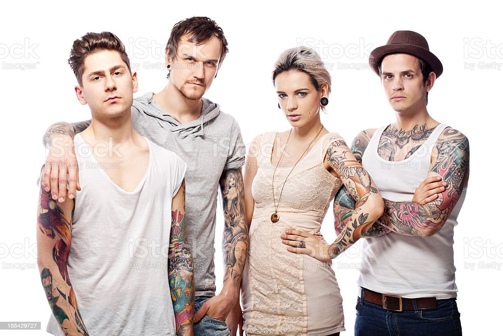 Young group of tattooed adults stock photo