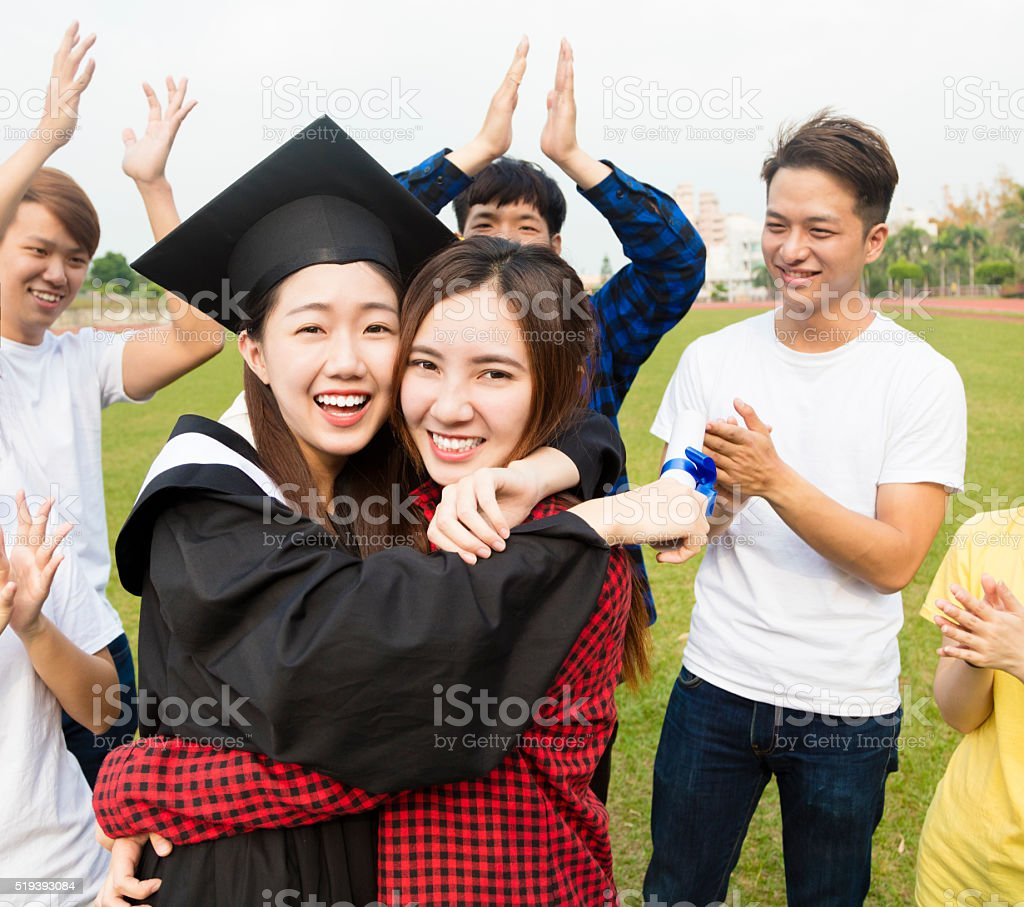 young group Students Celebrates Graduation in school stock photo