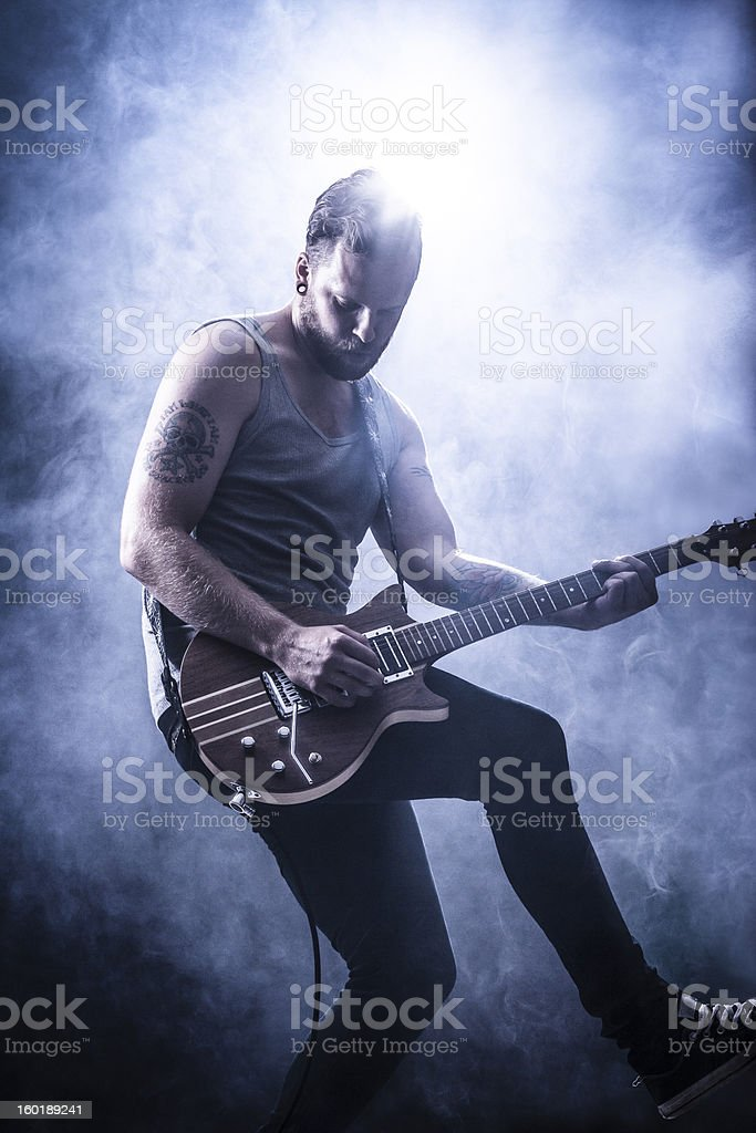 Young Guitar Player in Rock Concert stock photo