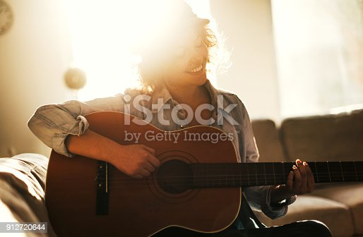 istock Young guitarist in dream scene 912720644