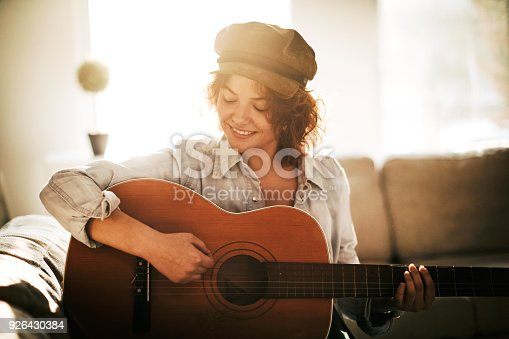 istock Young guitarist in dream scene 926430384