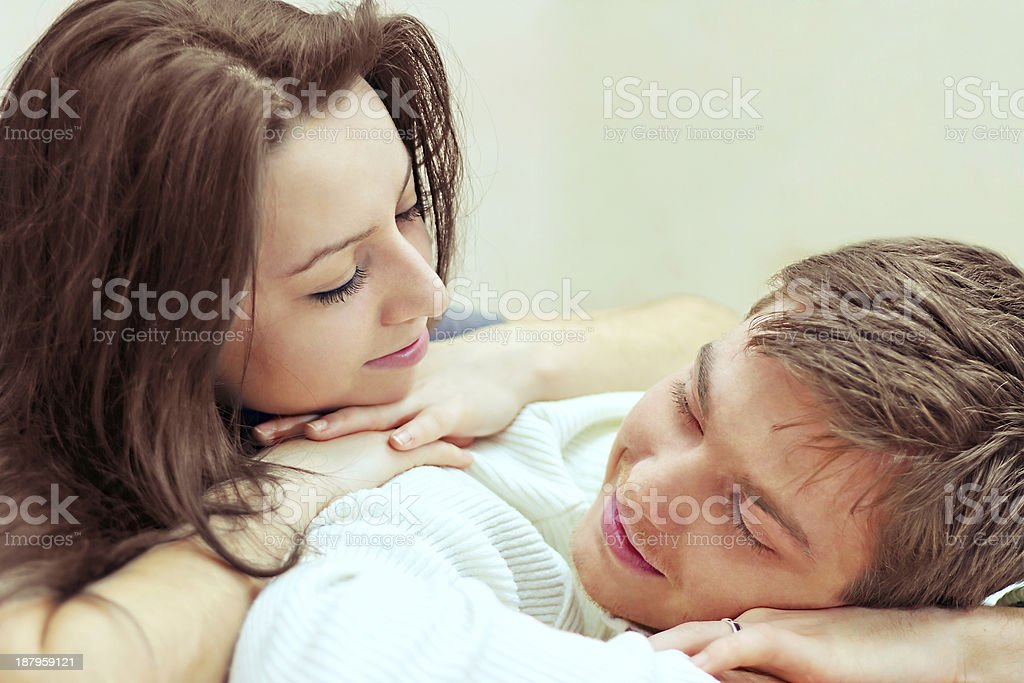 young guy and girl look at each other stock photo
