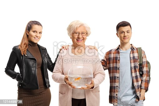 109350576 istock photo Young guy and girl posing with a senior woman holding a bowl with a goldfish 1214499738