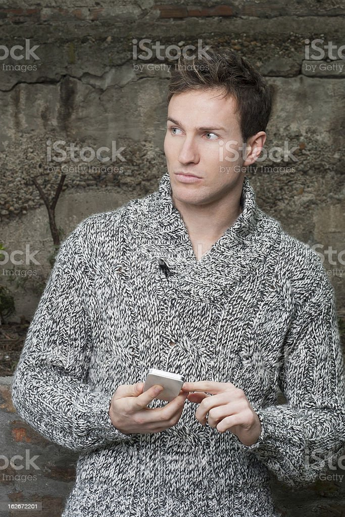 young guy at smart phone royalty-free stock photo