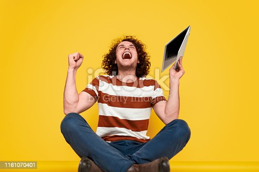 istock Young guy celebrating game victory 1161070401