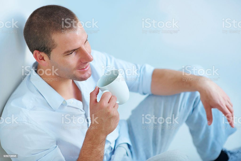 Young guy drinking coffee royalty-free stock photo