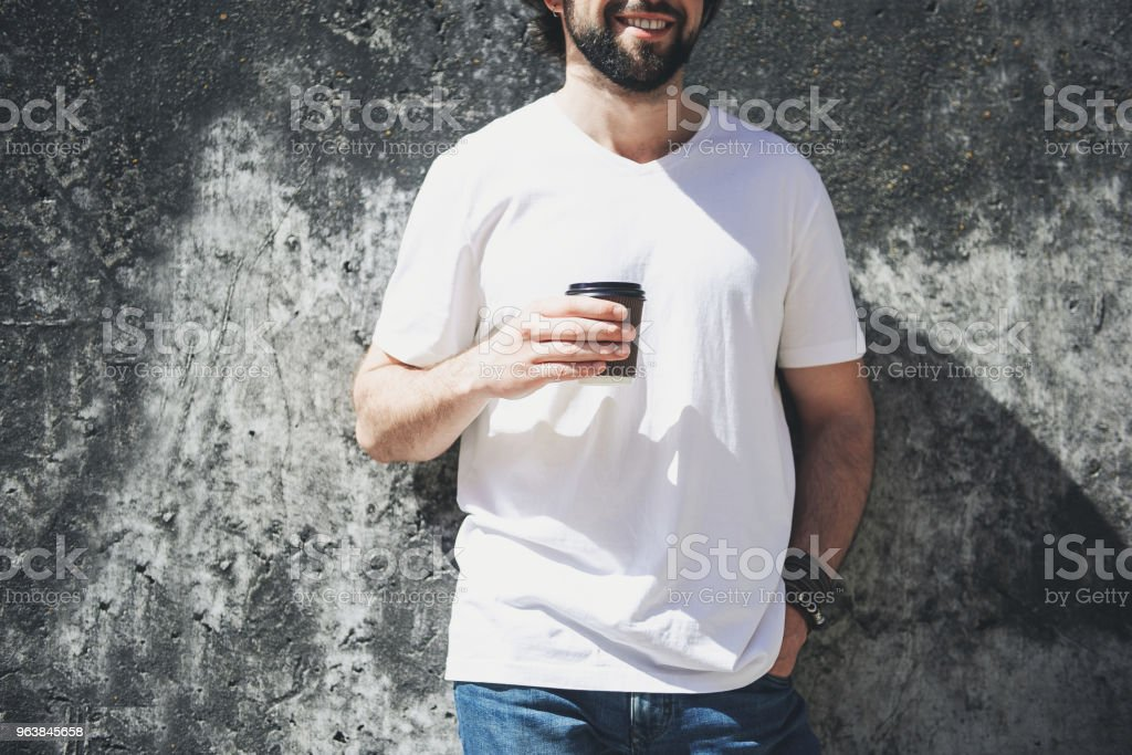 Young guy enjoying coffee on the street - Royalty-free Adult Stock Photo