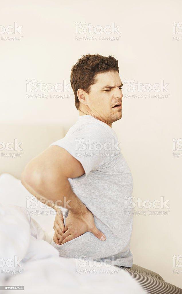 Young guy having backache royalty-free stock photo
