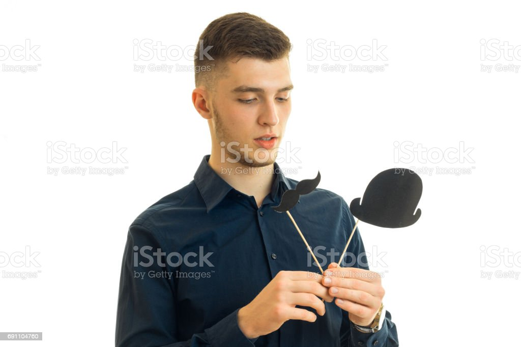 young guy holds paper props for photo close-up stock photo