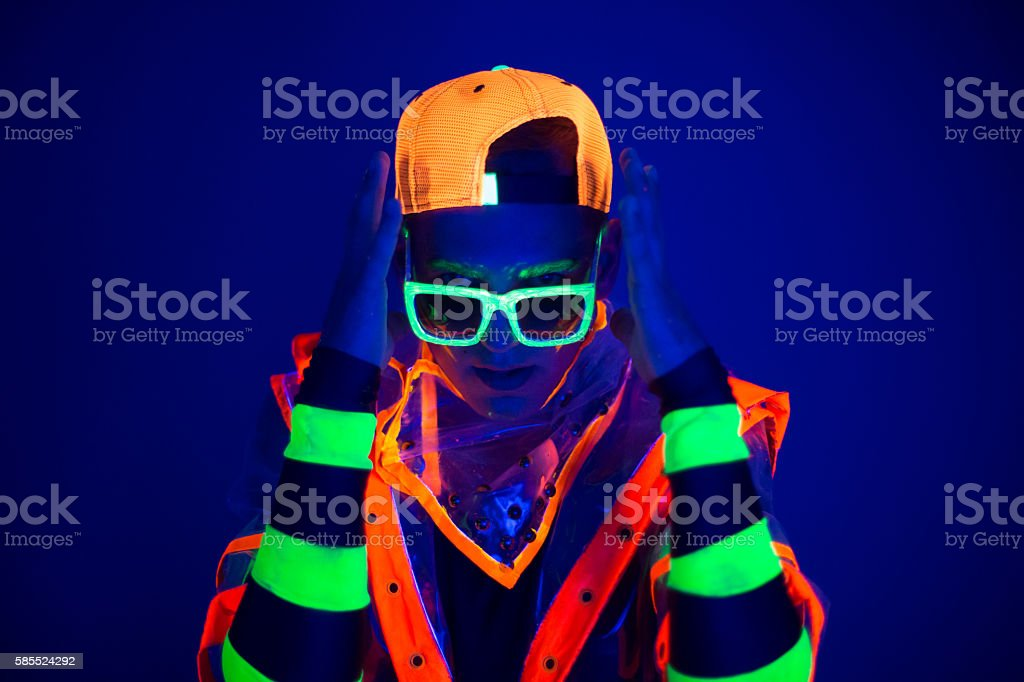 Young guy in creative costume with neon glow. stock photo