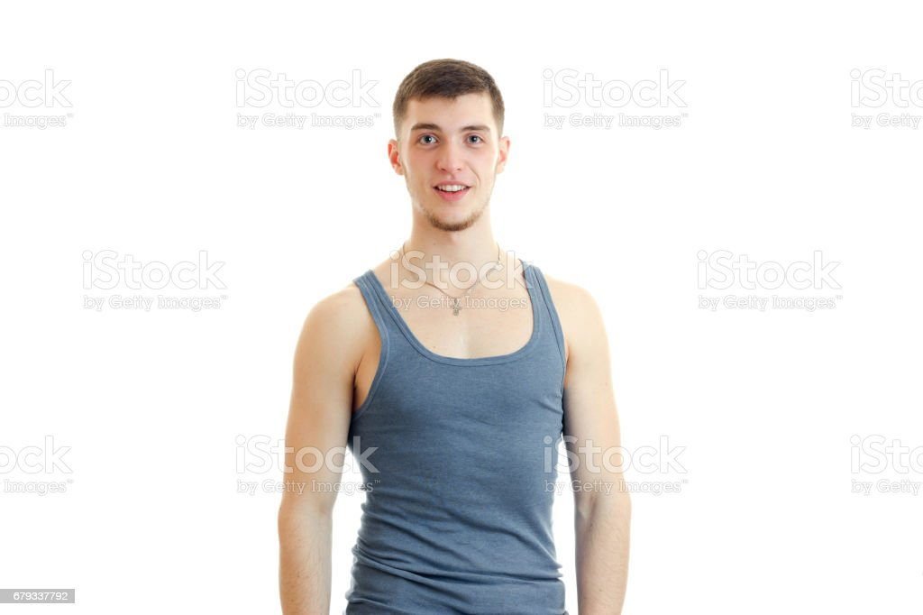 young guy in the gray shirt posing on camera royalty-free stock photo