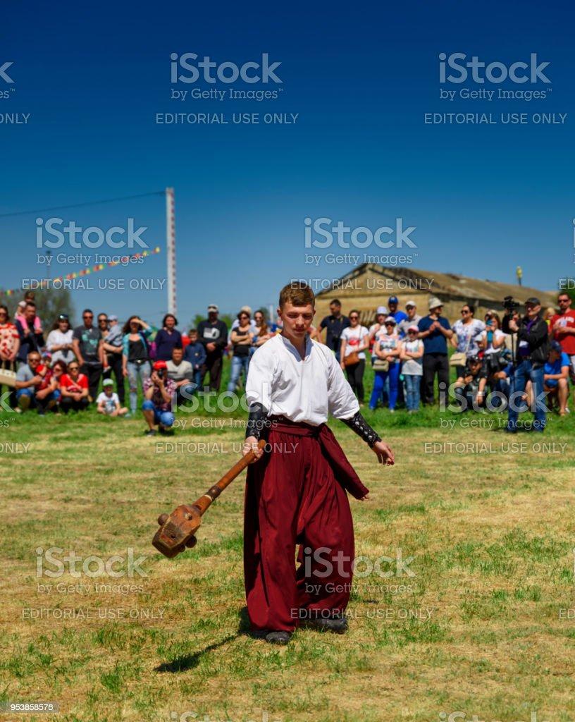 Kherson, Republicanets village, National park Kam'janska Sich , UKRAINE - APRIL 30, 2018: young guy in traditional Ukrainian clothes stock photo