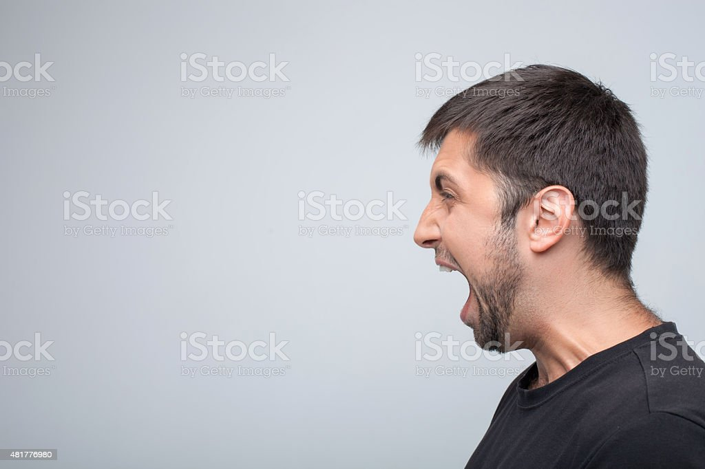 Young guy is expressing his negative emotions stock photo