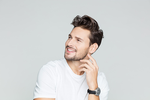 Young Guy Looking Away And Smiling Stock Photo - Download Image Now