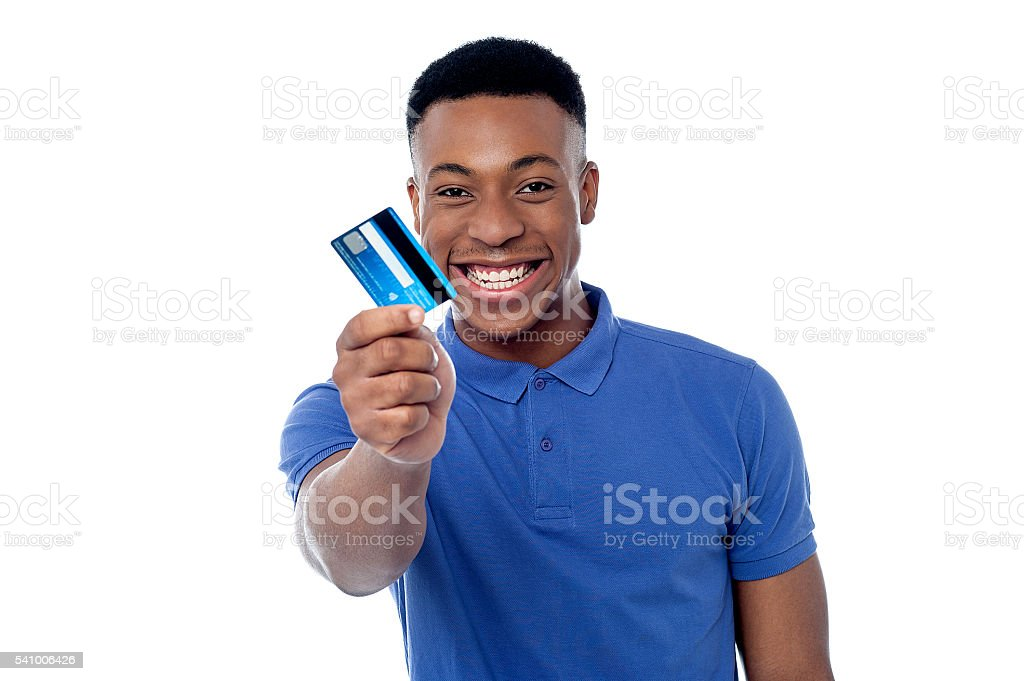 Young guy offering credit card stock photo