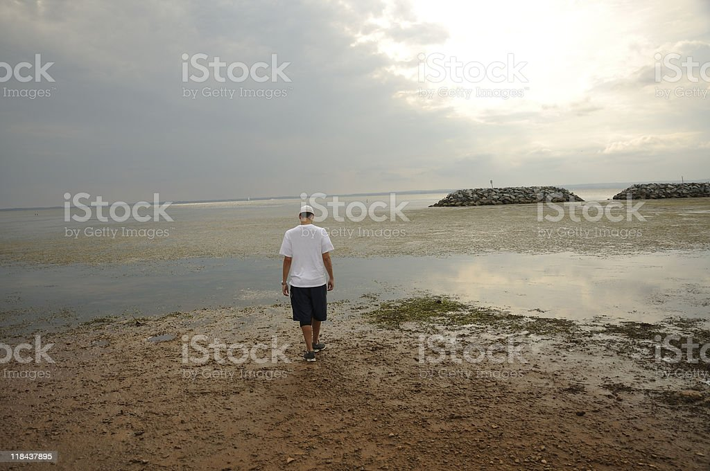 Young Guy on Coast at Sunset stock photo
