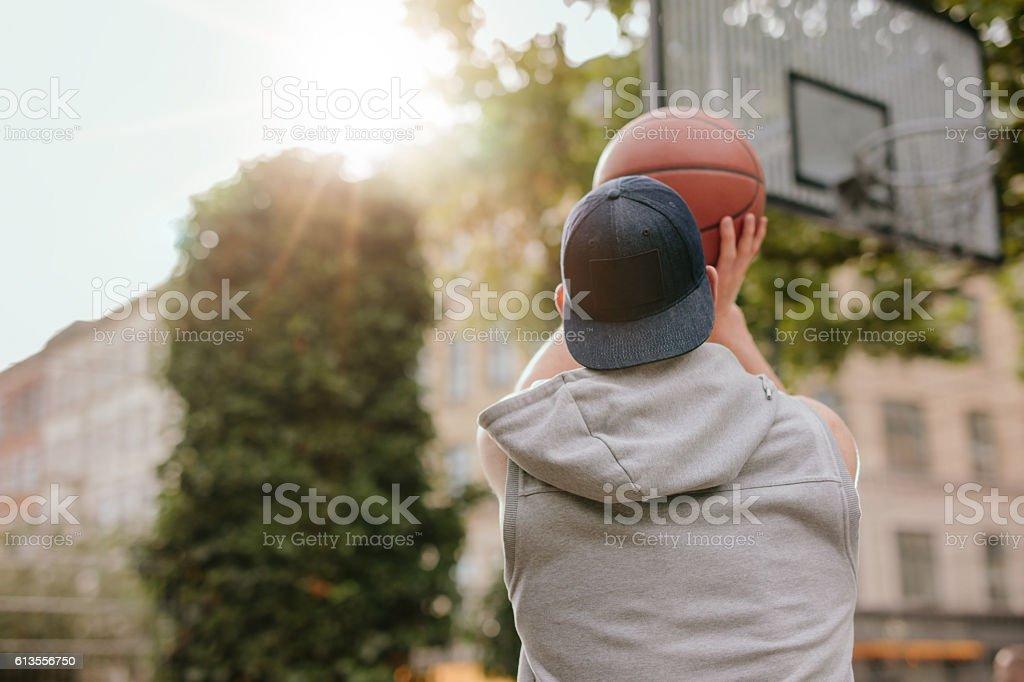 Young guy playing basketball stock photo