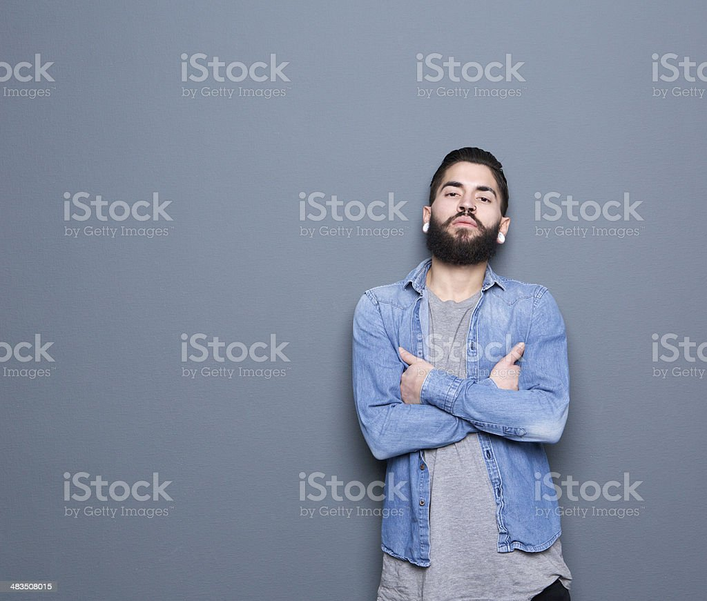 Young guy posing on gray background stock photo
