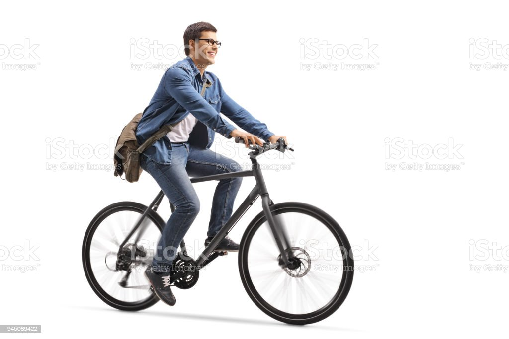 Young guy riding a bicycle stock photo